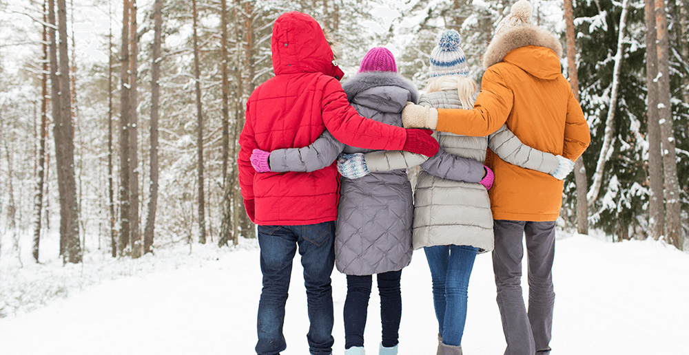Photo of a group of people walking in the snow.